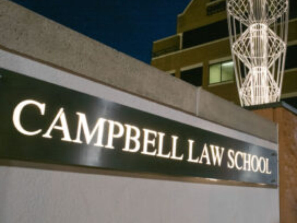 Photo of Campbell Law School sign and entrance at night
