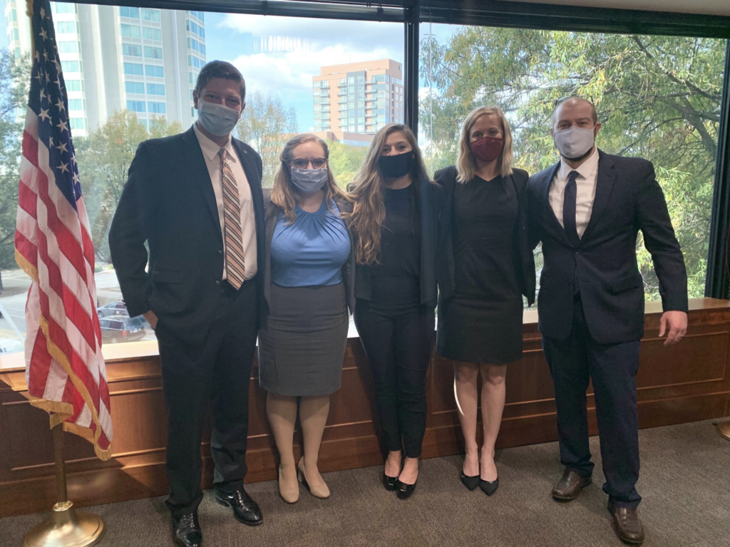 Photo of Campbell Law advocates posing in courtroom
