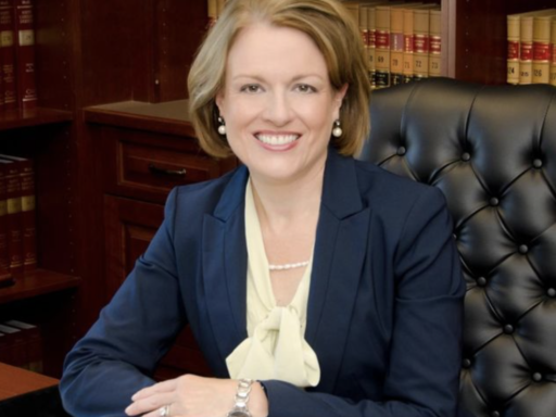 Photo of Chief Court of Appeals Judge Donna Stroud '85, '88 sitting at her desk.