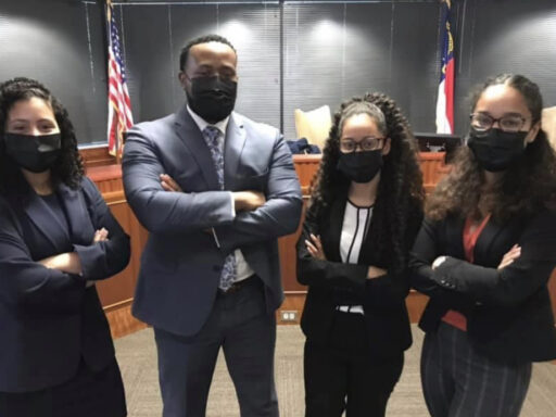 Photo of winning BLSA advocates posing in courtroom