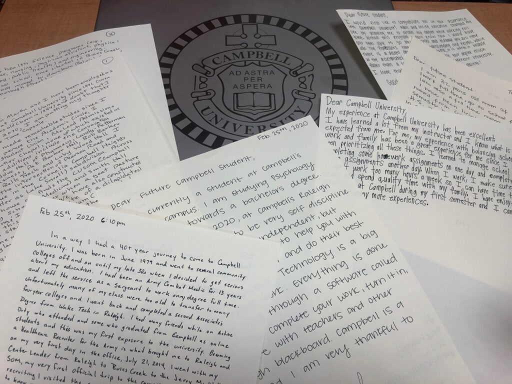 letters lay spread out on a table with a silver plaque of the Campbell crest