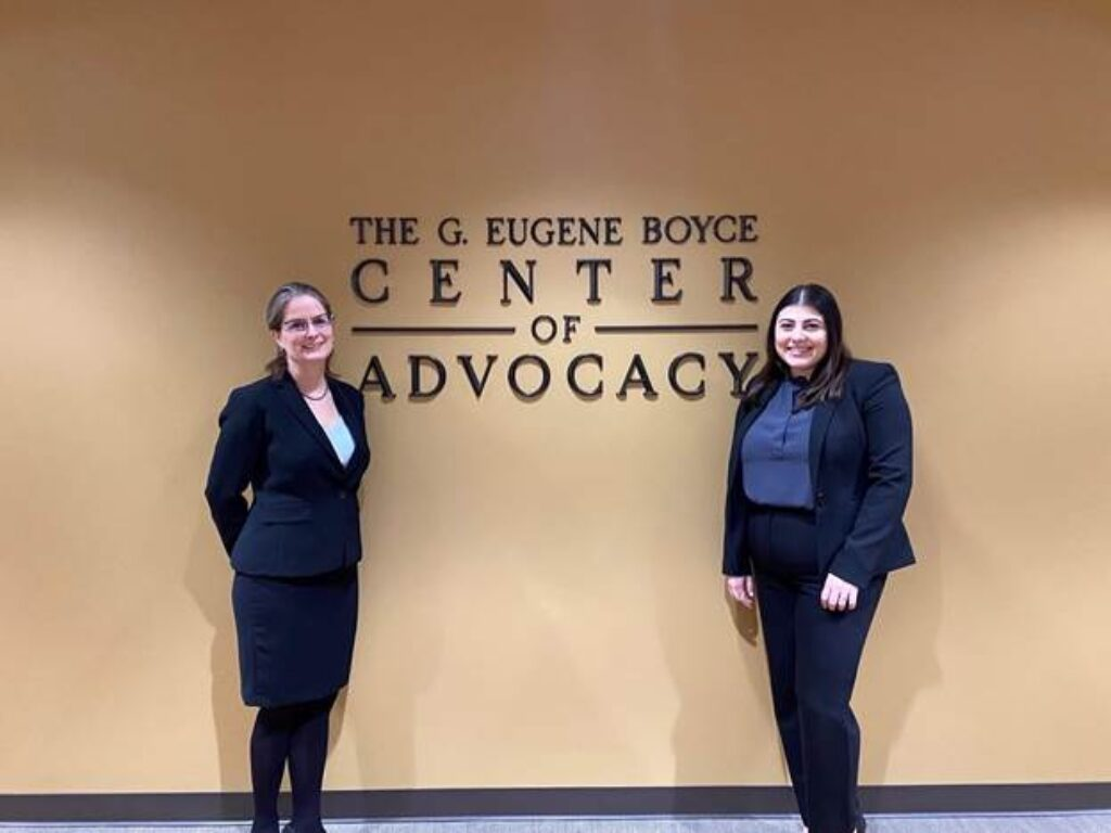Photo of Campbell Law Environmental Law Moot Court competitors in front of Gene Boyce Advocacy Center Sign