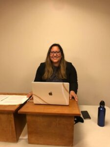 Photo of Campbell Law advocate in front of laptop competing in Jerome Prince