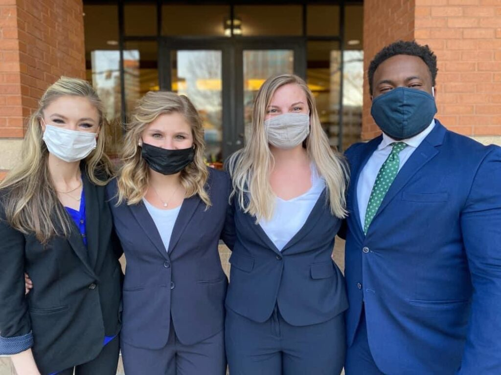 Photo of four Campbell Law students who competed in South Texas Mock Trial Competition in 2021