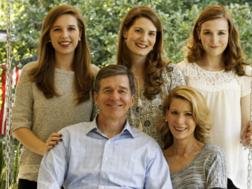 Photo of N.C. Gov. Roy Cooper, his wife Kristin '82 and their three daughters