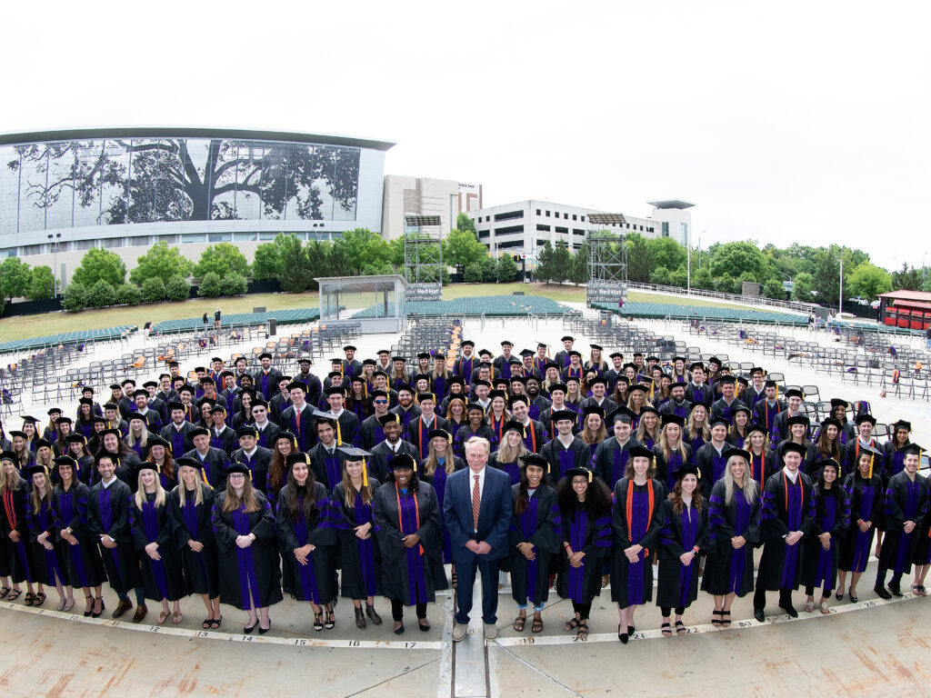 Photo of Campbell Law School Class of 2021 in Red Hat Amphitheater and Dean Leonard