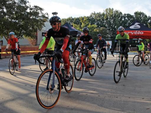 Photo of bike riders leaving law school parking lot
