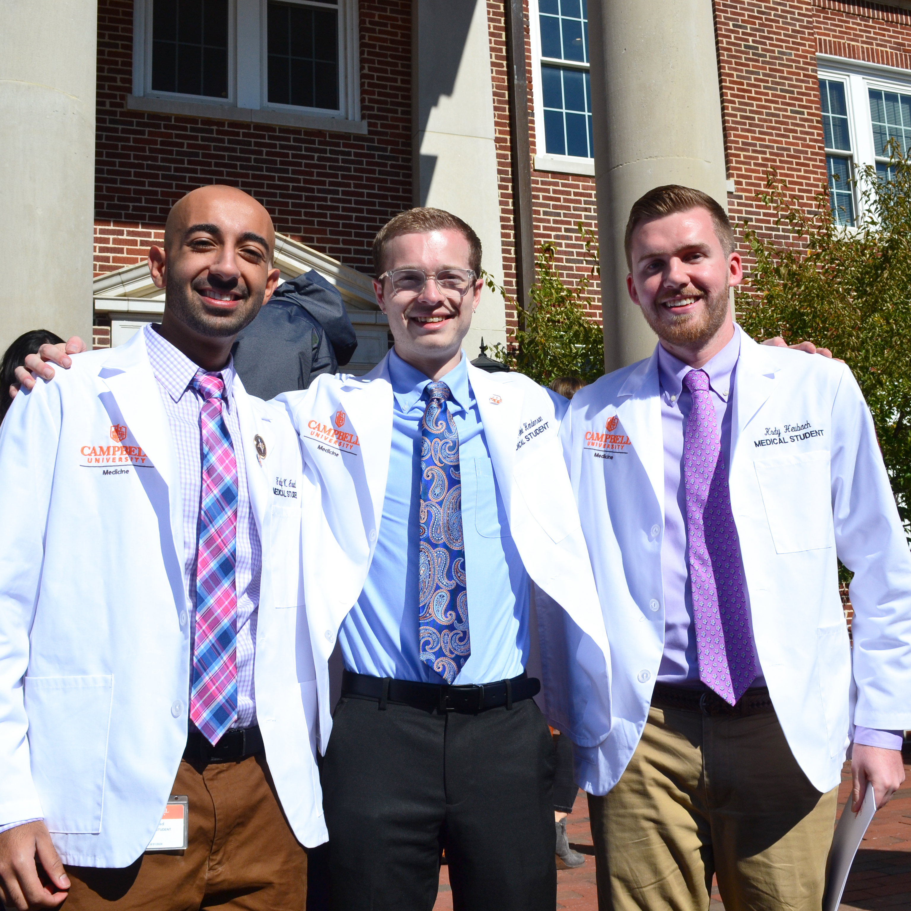 Male students in white coats