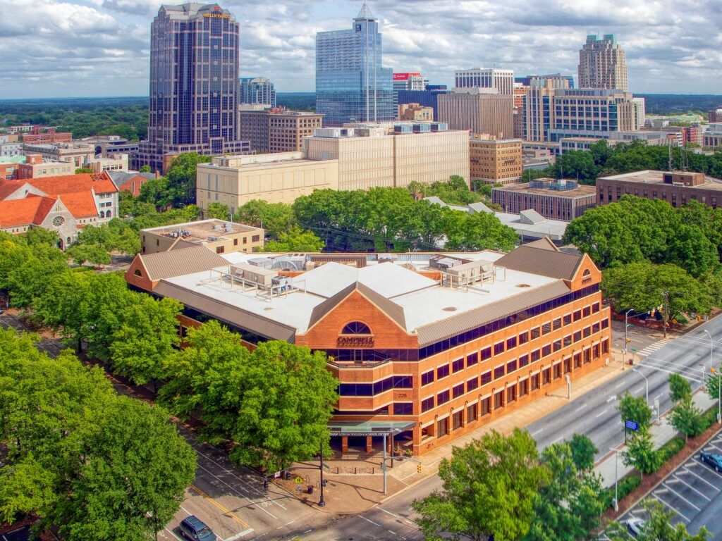 Aerial photo of Campbell Raleigh Campus and Law School with downtown Raleigh in the background