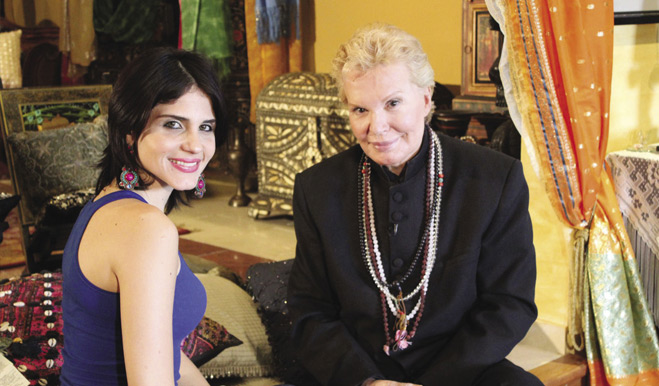 Astrid Rivera (left) interviews famed Puerto Rican television personality Walter Mercado