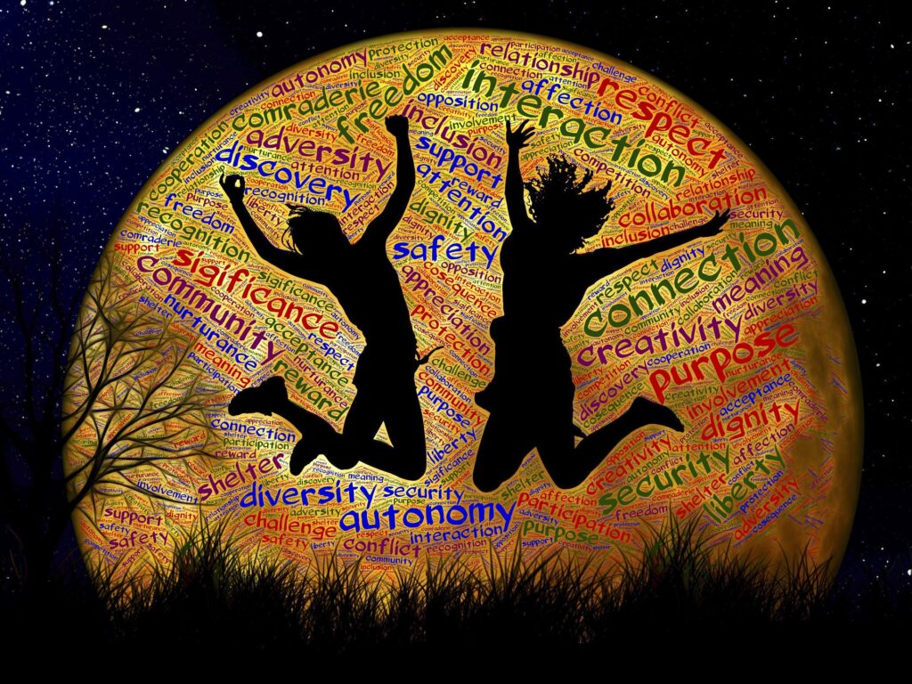 image of teens jumping in the moonlight