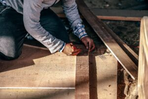 man working with pwood plank