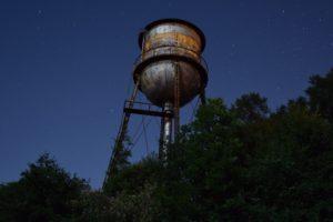 Watertower against the night sky