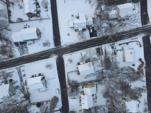 Overhead view of a small town intersection in the winter