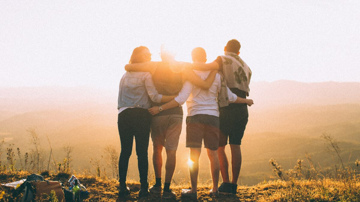 group of peolpe looking at a sunrise