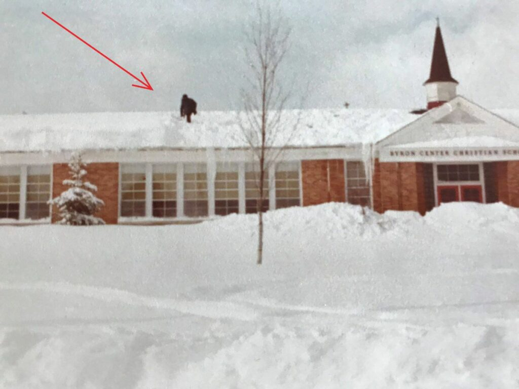 Fifty-nine-year-old Gerald Bronsink shoveling snow from the roof of Byron Center Christian School after the blizzard of 1978 dumped a record 18.4 inches in Grand Rapids, Mich.