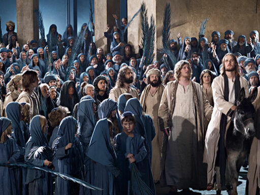 Actors portray Jesus' entry into Jerusalem in the Passion Play