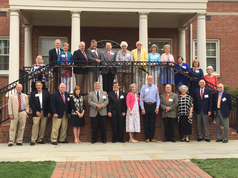 The Class of 1969 attendees pose for a group photo outside of Marshbanks Dining Hall.