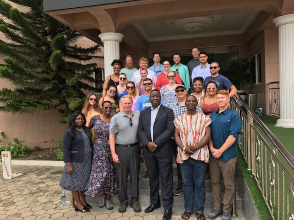 Group of Campbell Law students, professors and administration pose for photo on first day in Ghana