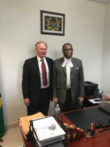 Photo of Dean Leonard posing with Ghanian Justice Charles Baden