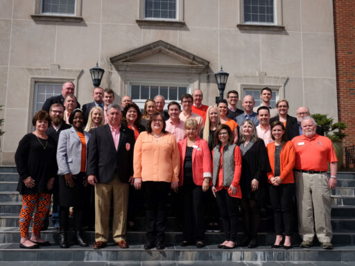 Photo of the Alumni Board of Directors standing on the steps of Taylor Hall.