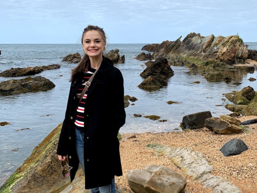 Photo of Savannah Singletary '20 posing near the shore in Scotland