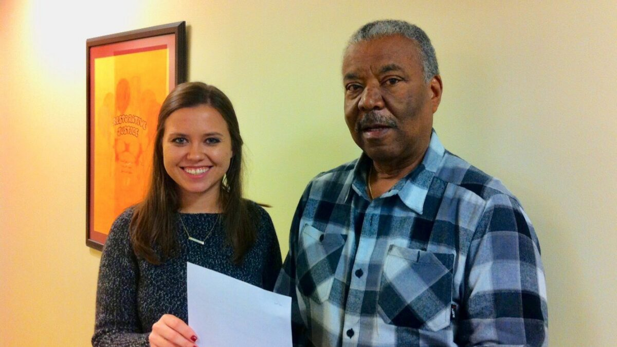 A Senior Law Clinic student is pictured with an elderly man she helped
