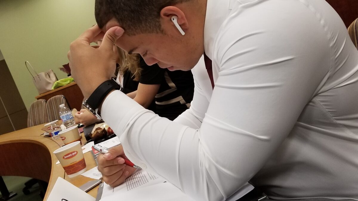 Photo of Kevin Littlejohn '20 studying during a competition