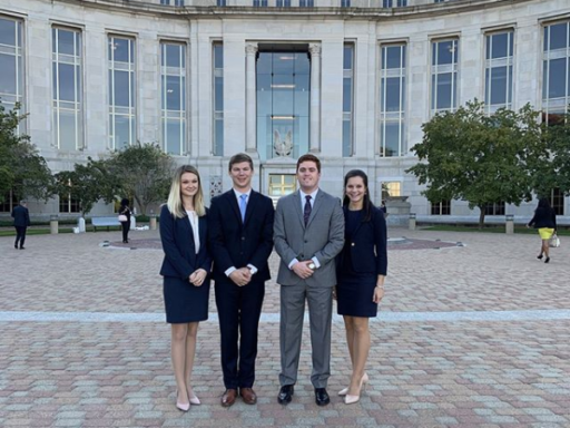 Photo of four Campbell Law advocates standing in front of Montgomery, Alabama court house