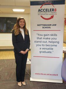 Photo of Lindsey Reedy '20 standing in front of a Nottingham Law school sign