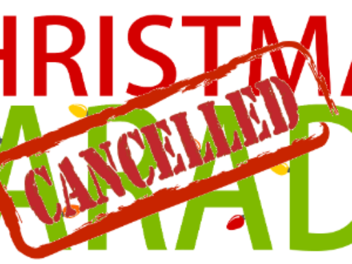 Graphic with red and green letters stating Christmas Parade with a cancelled stamp over the words