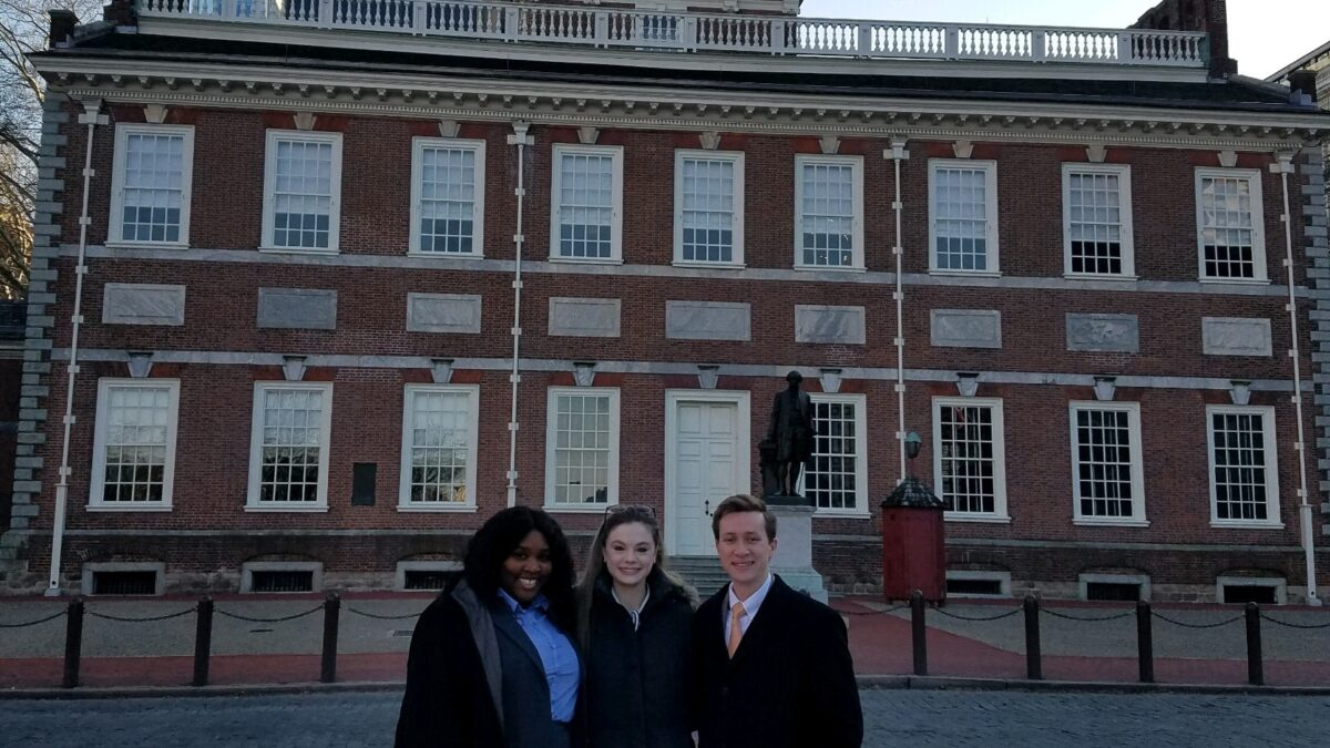 Photo of three Campbell Law advocates standing in front of Constitution Hall in Philadelphia