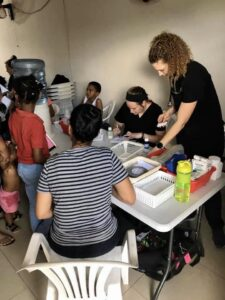 students on mission trip help patients