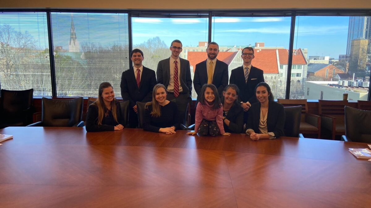 Photo of the Willem Vis team and Professor Papadima and her daughter posing in the Dean's Conference Room