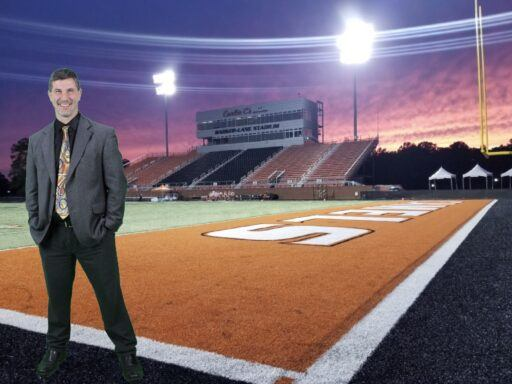 Dr. Phillips standing on the Football field with a sunset.