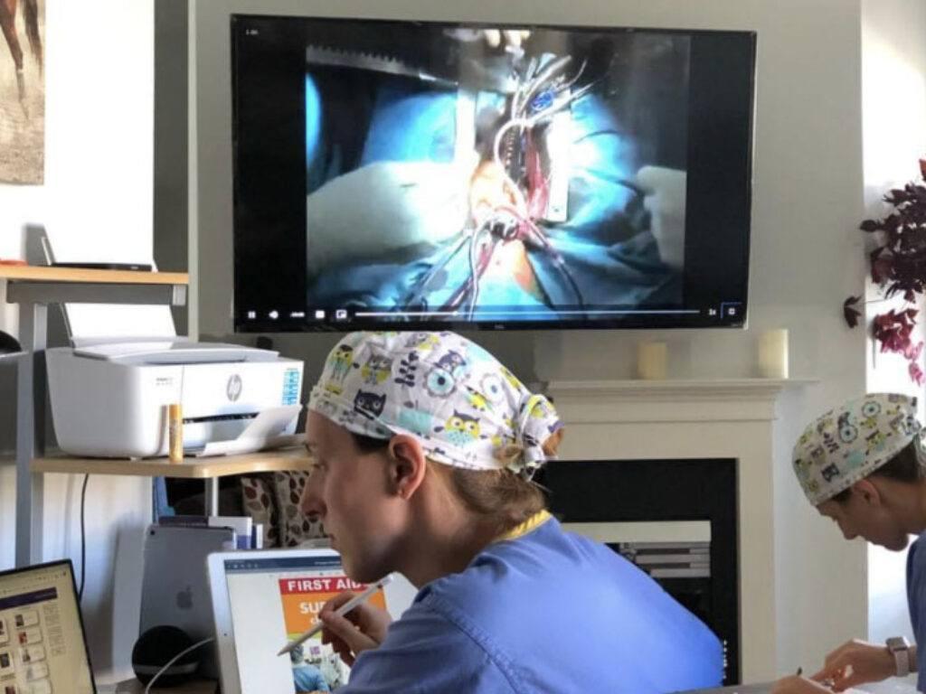 medical students looking at virtual surgery