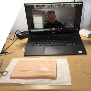suture kit with laptop showing instructor