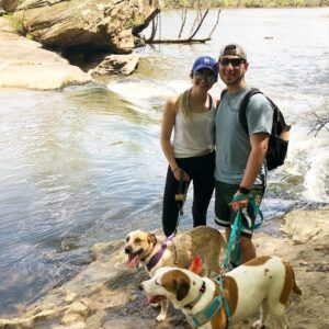 Allí Howell with dogs at the river