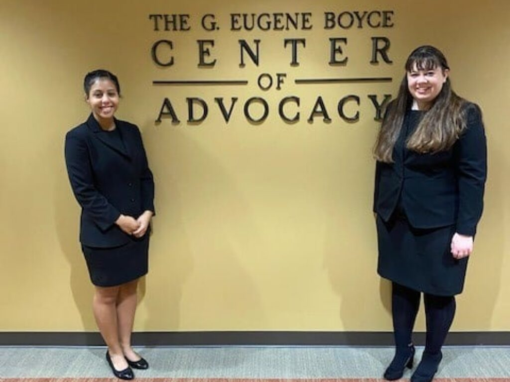 Photo of Campbell Law Advocates posing in front of Gene Boyce Center for Advocacy sign