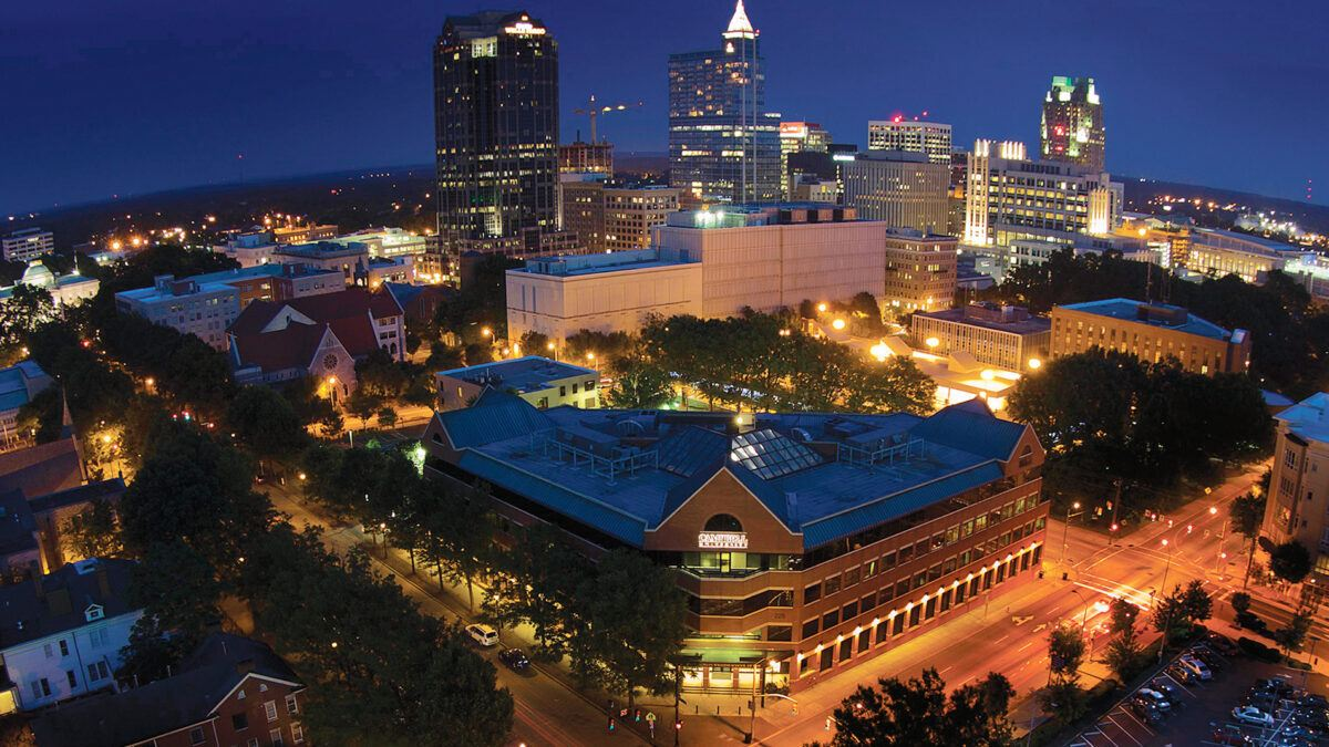 image of law school and downtown raleigh at night