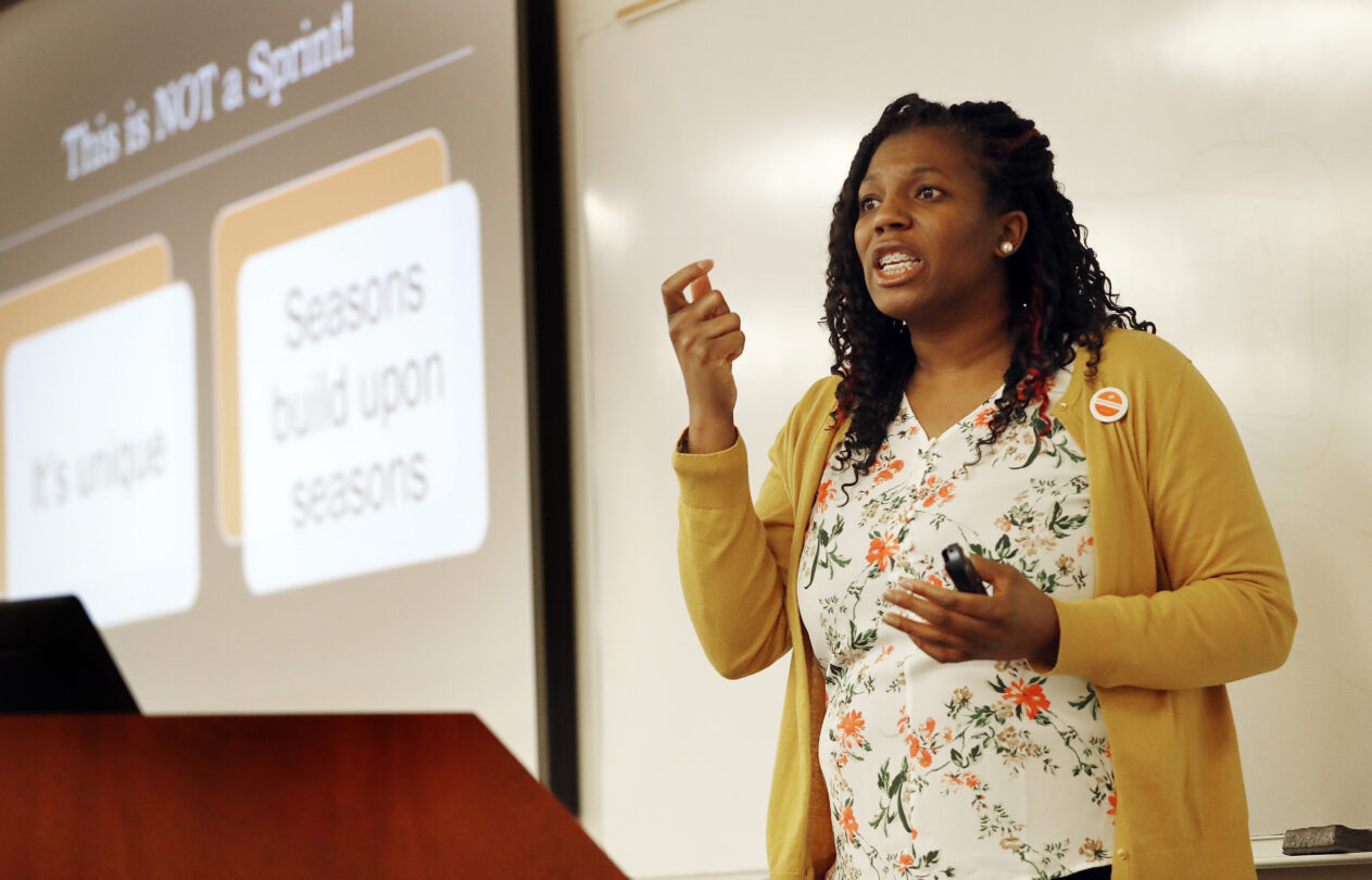 Photo of Niya Fonville teaching in front of classroom